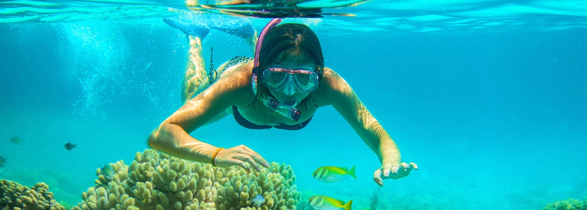 girl snorkeling in the waters of mexico