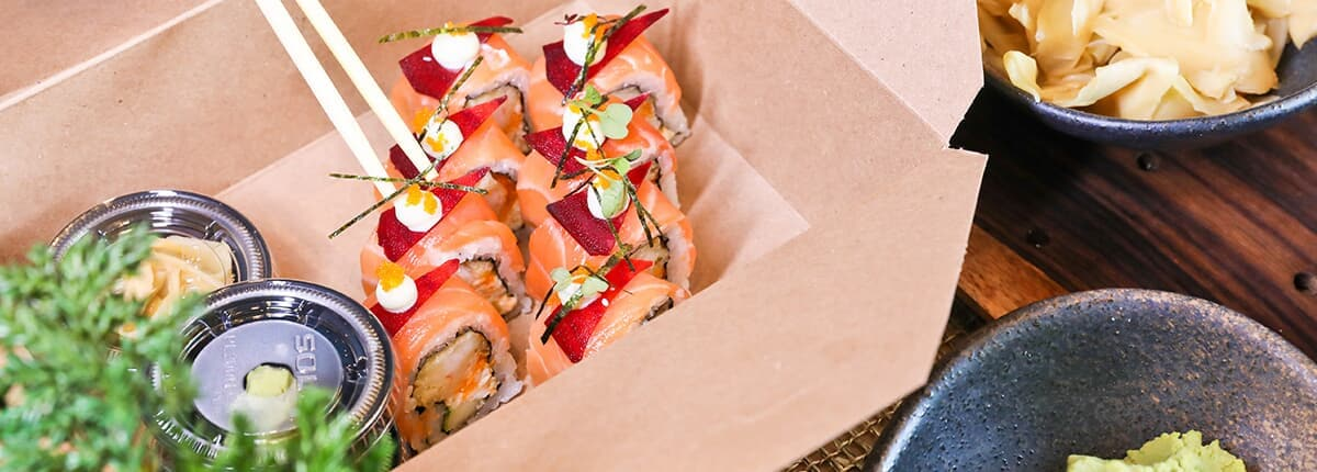 a sushi roll in a take out container