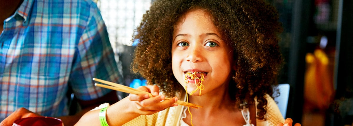 A child enjoying noodles at JI JI Asian Kitchen