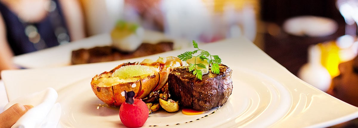 steak and lobster entree in the dining room on carnival cruise line