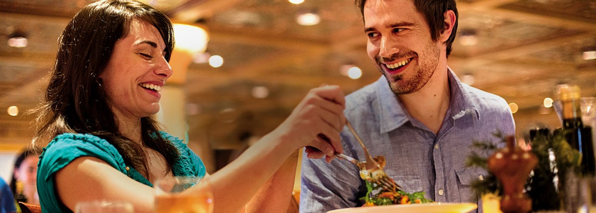 couple enjoying food on a carnival cruise