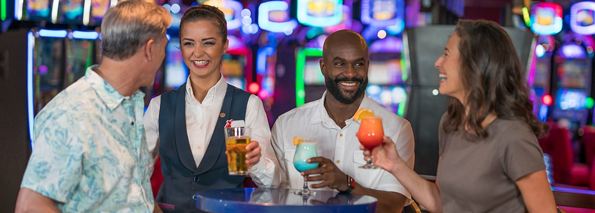 people enjoying drinks at the casino bar on carnival cruise line