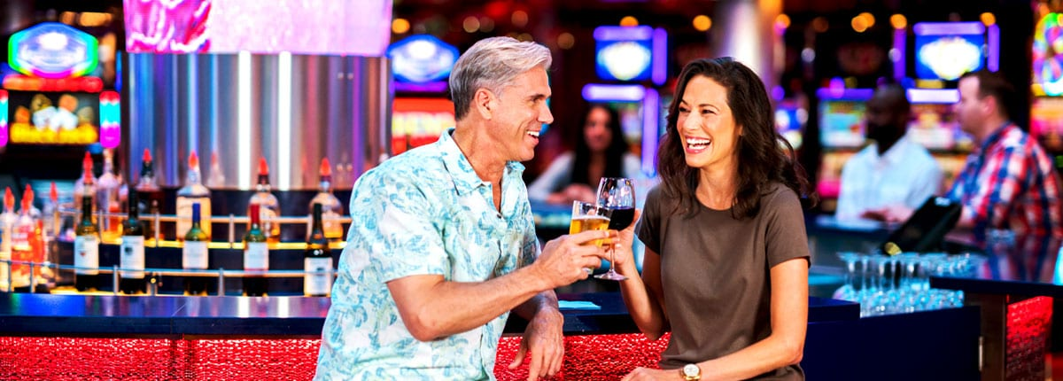 man and woman enjoying a drink at the carnival casino bar
