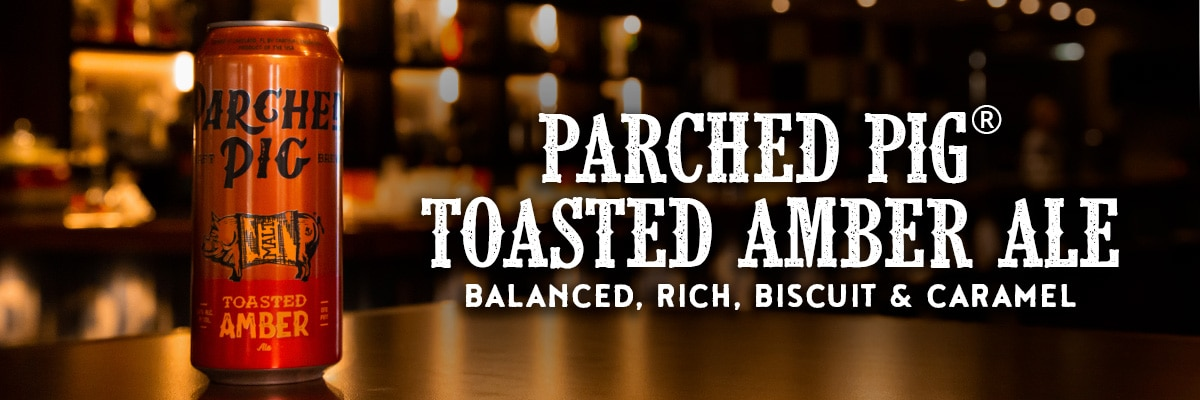 parched pig toasted amber ale with parched pig toasted amber ale logo and words balanced, rich, biscuit and caramel