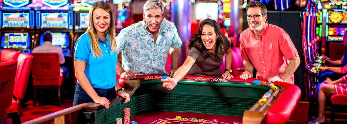 guests play casino tournaments games on carnival cruise line