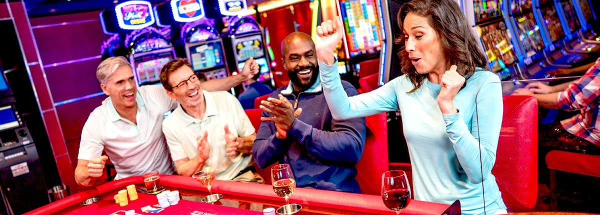 guests playing table games at the casino on carnival cruise line