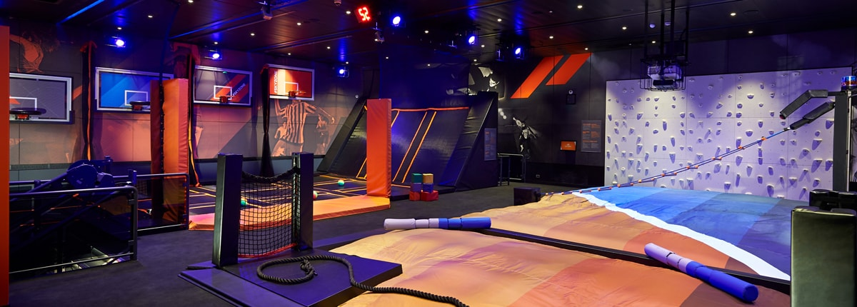 sky zone logo - group of guests jumping on trampolines, playing dodgeball and dunking basketballs at the first sky zone at sea