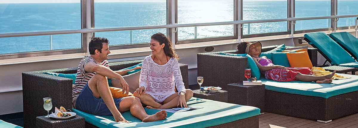 couple enjoying the serenity adult-only retreat on carnival cruise lines