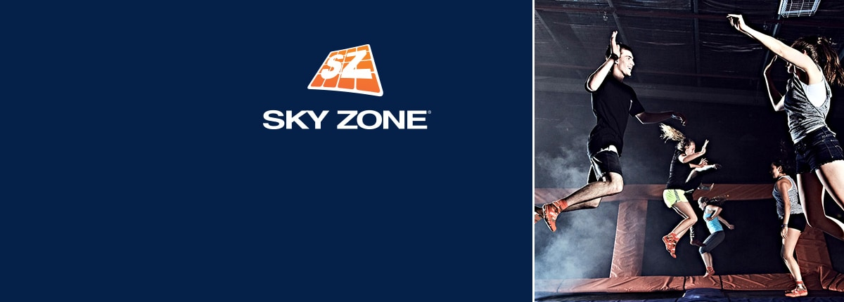 sky zone logo - group of guests high-fiving while jumping on trampolines