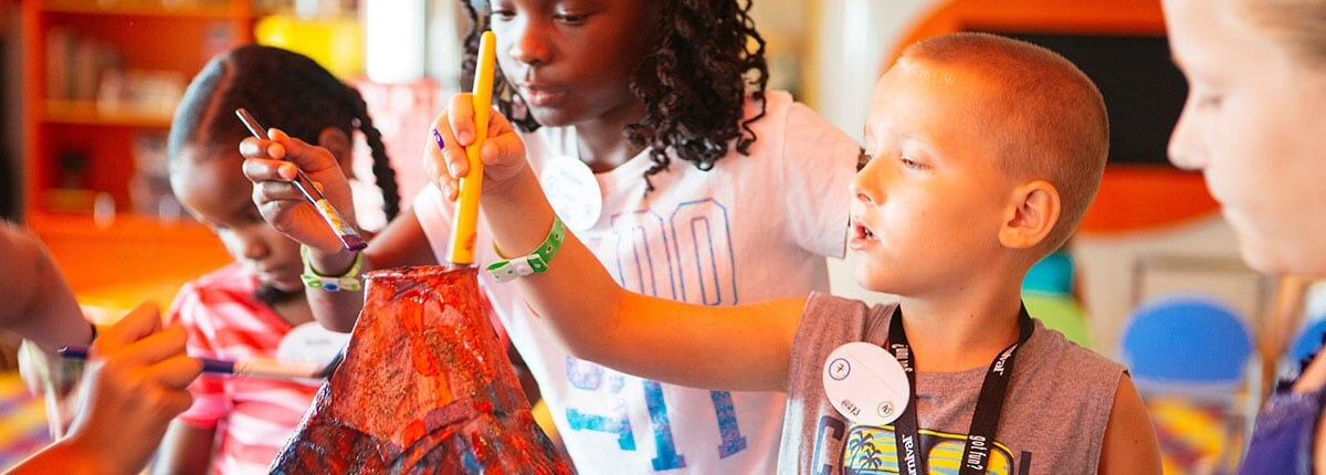 children enjoying arts and crafts aboard a carnival cruise ship