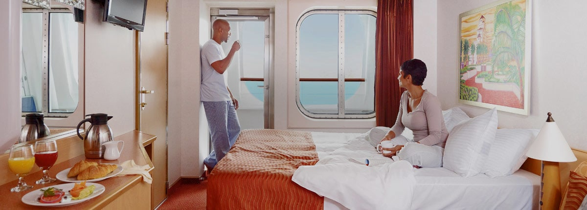 couple enjoying the stateroom on carnival cruise line