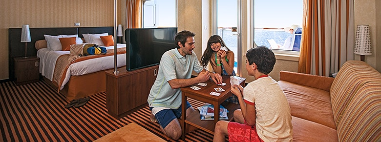Family playing cards in a Carnival Cruise Line suite