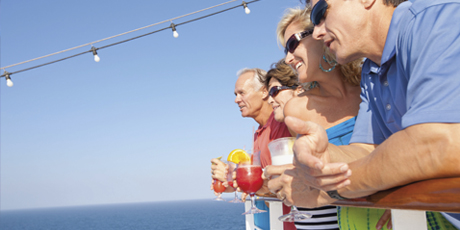 a group having drinks while looking out to sea